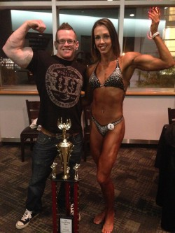 Pose down with my biggest supporter. His biceps are just slightly larger than mine...
