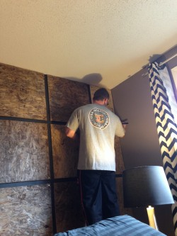 Kyle putting the finishing touches on the feature wall in our bedroom.