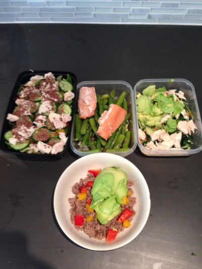 Four of my six meals - protein from chicken, ground beef, and salmon. Plenty of veggies and fat from flax seeds, avocado, olive oil, and the beef and salmon. Not pictured are my pre / post workout shakes and a serving of Greek yogurt.