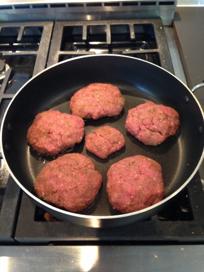 Searing the burgers first will help prevent them from drying out when you fully cook them.